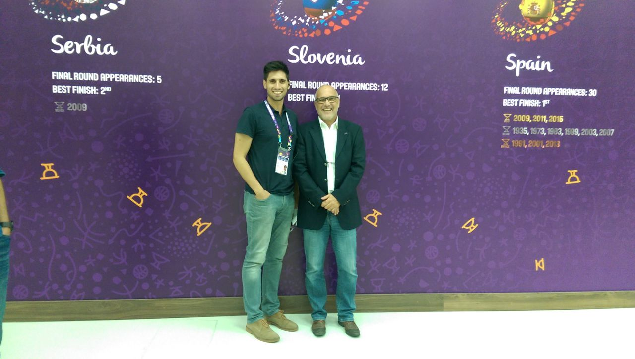 two men posing for a picture at basketball EC finals