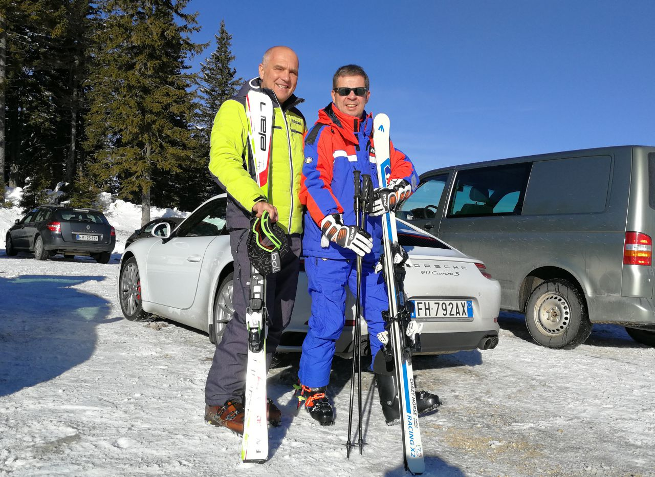 two skiers in a parking