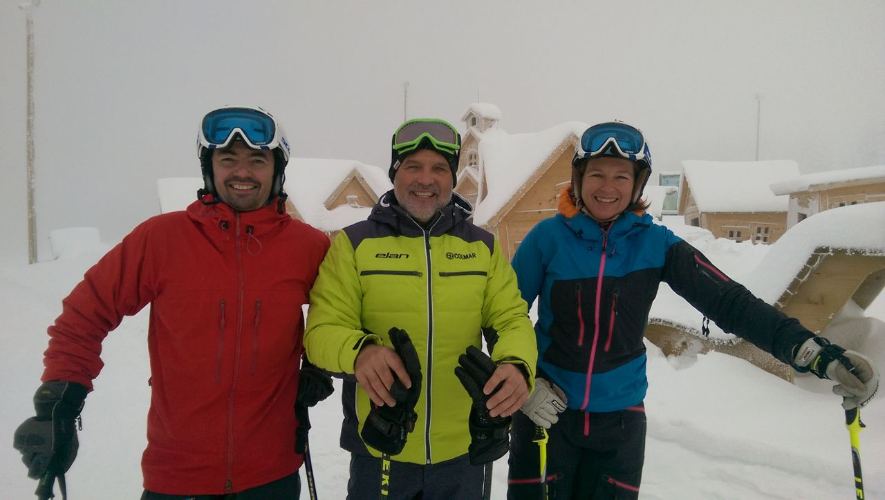 skiers posing for a picture