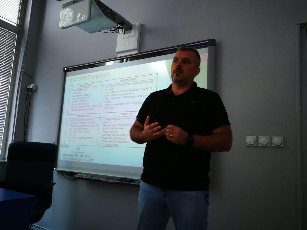 man lecturing