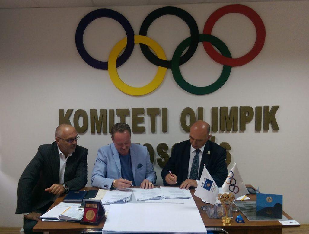 Signing documents at NOC Kosovo