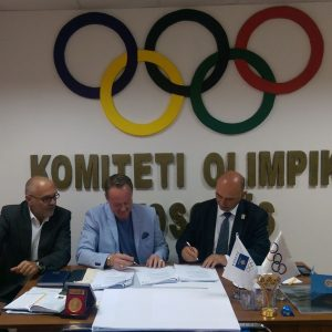 Signing documents at NOC Kosovo