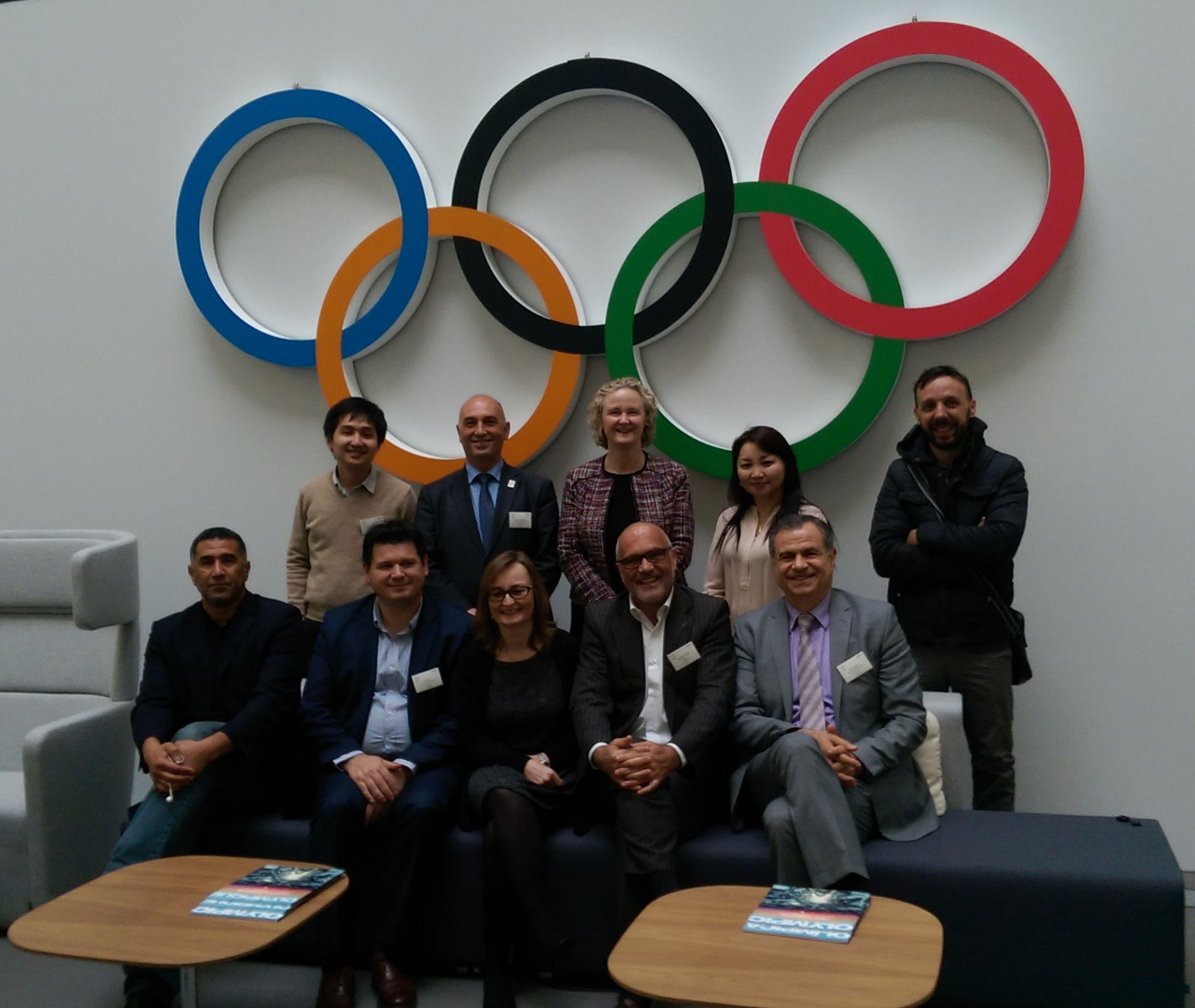 group photo under the olympic logo