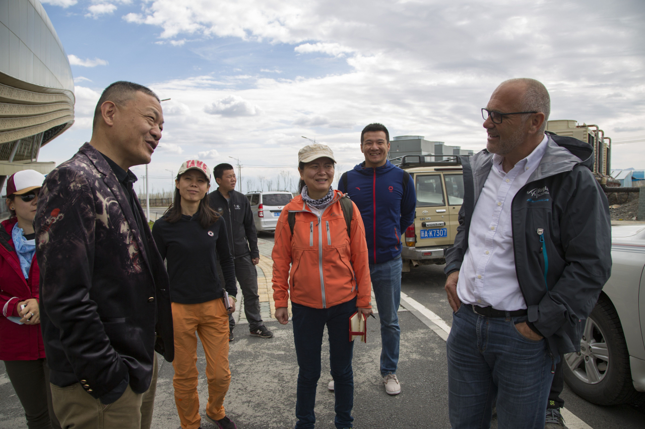 people talking in a street