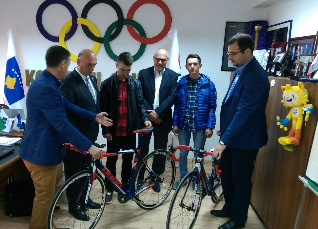 handing over bikes to young athletes