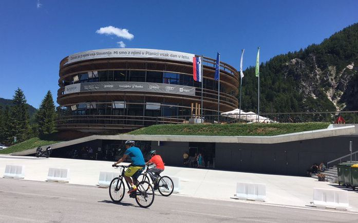 bike riders in front of Planica Nordic Centre