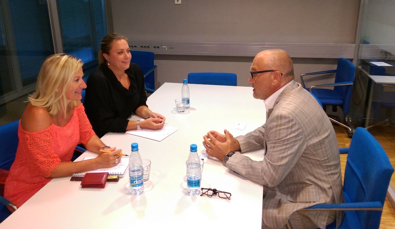 man and two women in a conference room