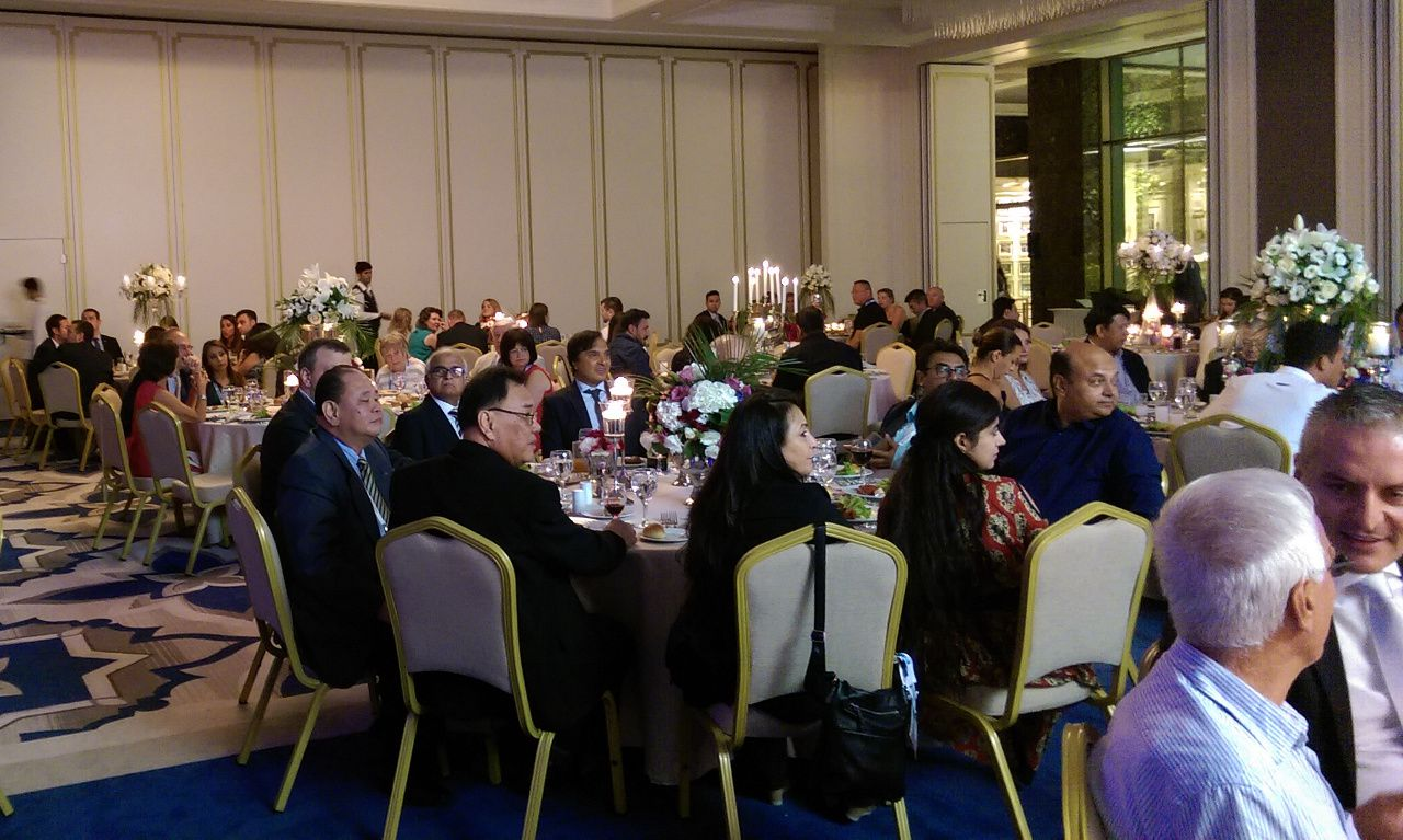 people at an official dinner