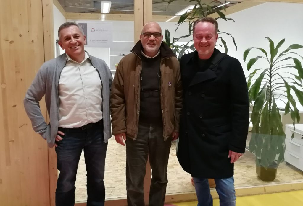 three business partners posing for a picture