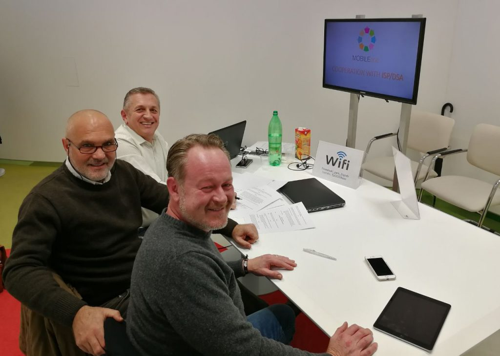 men in a conference room