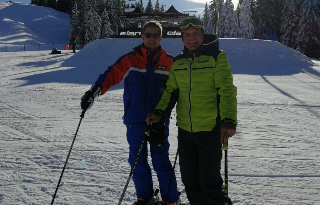 two skiers posing for a picture