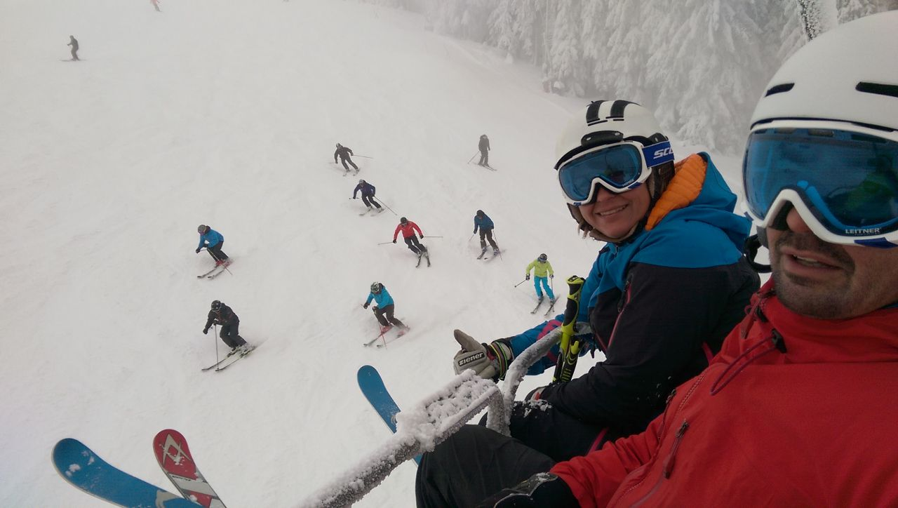 skiers on a chair lift