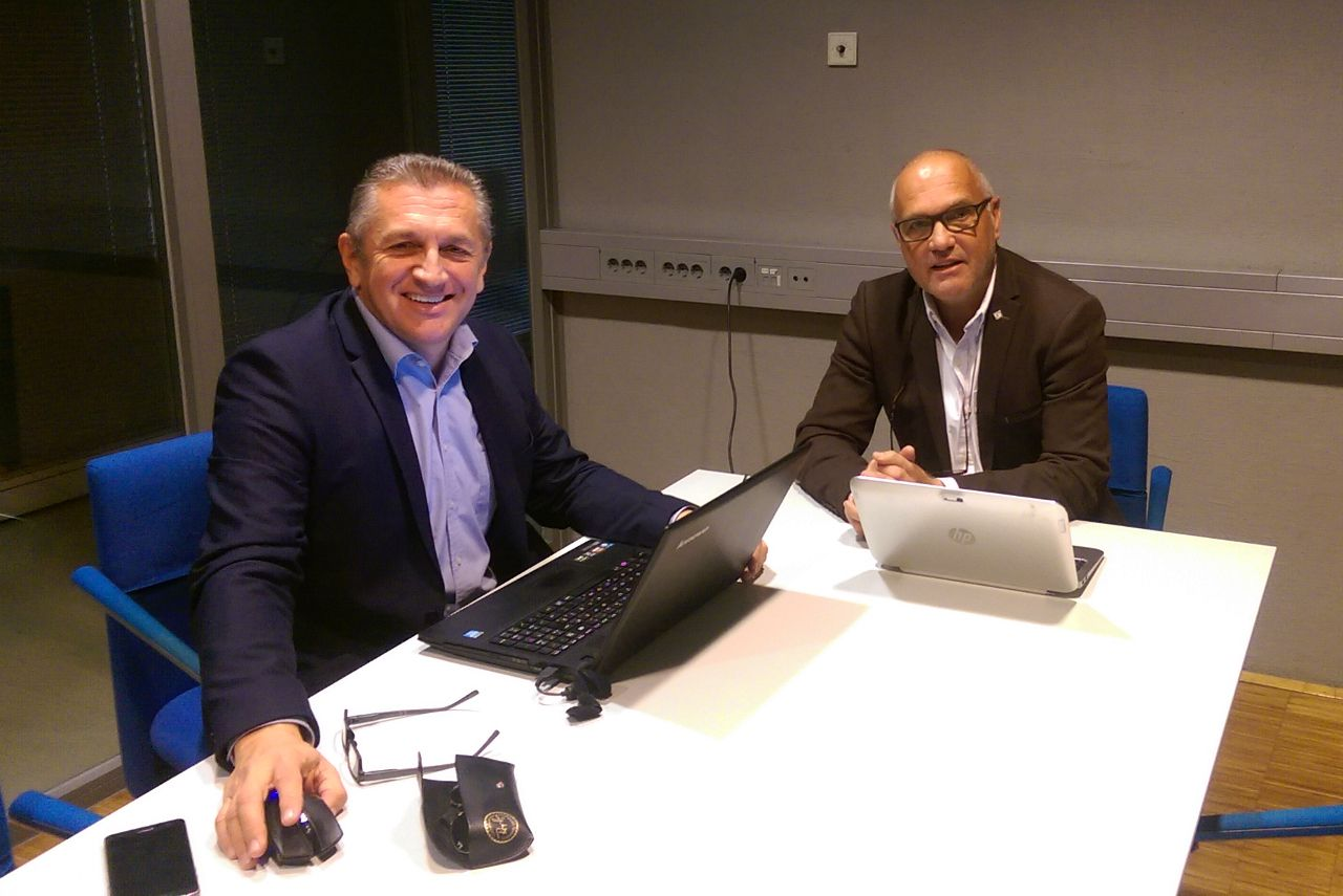 two men in a conference room
