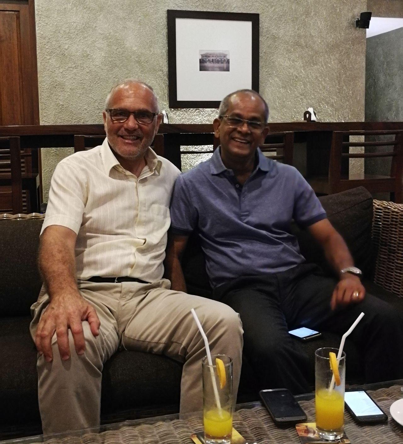 two men in an informal business meeting