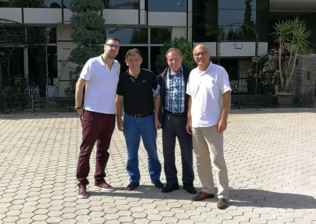 four men posing for a picture
