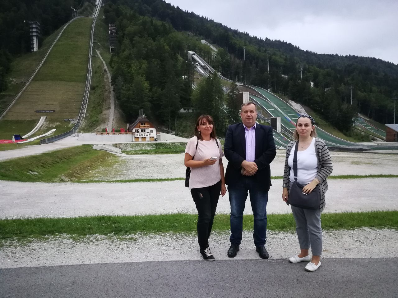 three people in fornt of Letalnica